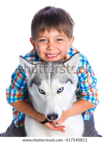 Cute boy with her dog husky isolated on white background