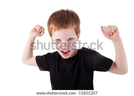 cute boy with his arms raised,  isolated on white background. Studio shot