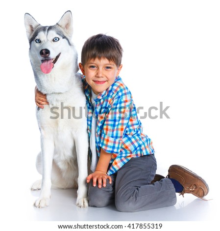 Cute boy with his dog husky isolated on white background - stock photo