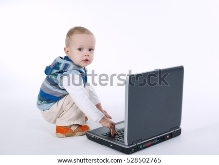 cute boy with laptop on white