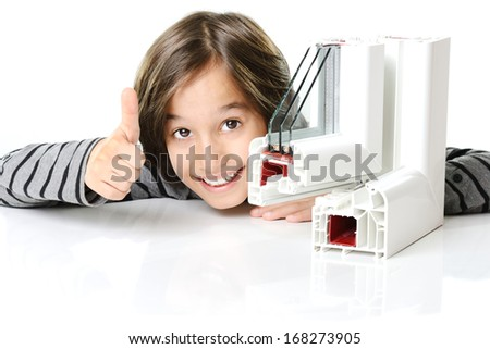 Cute boy with plastic pvc window profile - stock photo
