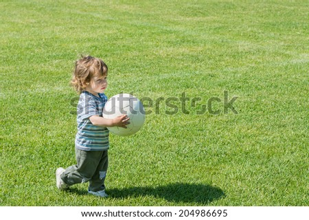 cute boy with soccer ball - stock photo