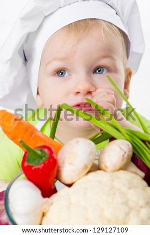 cute boy with vegetables closeup - stock photo