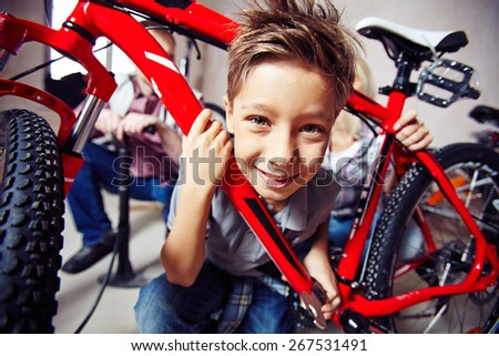 Cute boy with wrench looking at camera - stock photo
