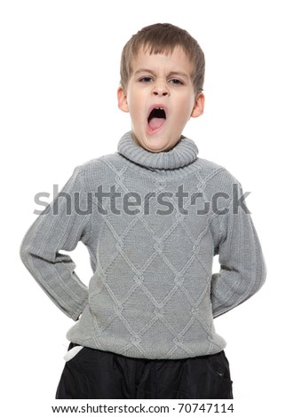 Cute boy yawning isolated on a white background