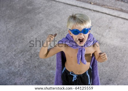 Cute boy, 7 years, in pretend superhero costume - stock photo