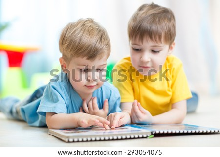 Cute boys at home reading - stock photo
