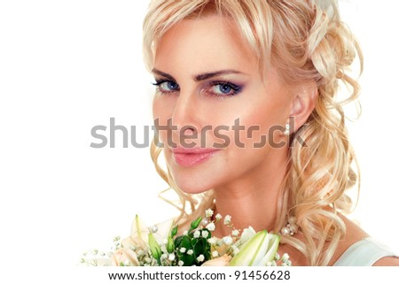 cute bride looking on white with flowers