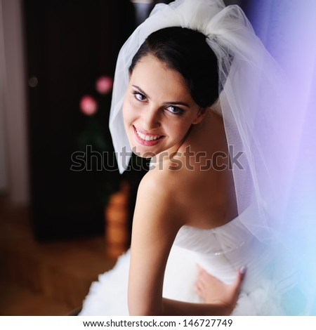 cute bride posing at home  in the morning