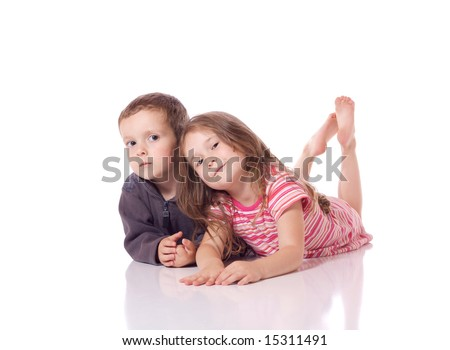 Cute brother and sister laying on their stomach