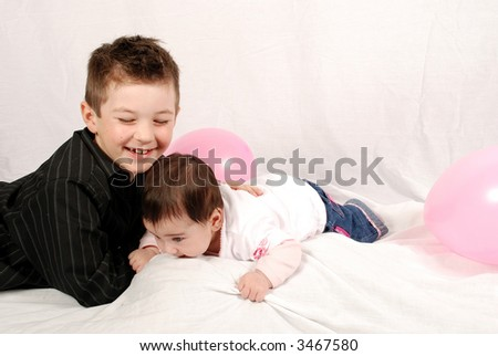 cute brother and sister playing - stock photo