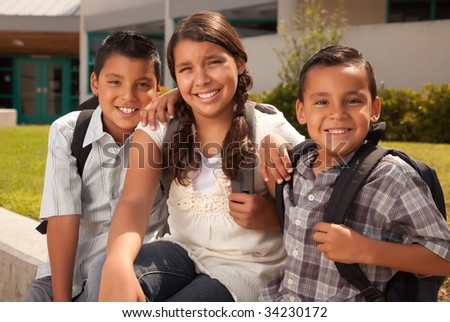 Cute Brothers and Sister Wearing Backpacks Ready for School. - stock photo