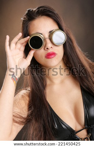 Cute brunette and welder goggles - stock photo