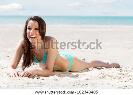 Cute brunette at the beach