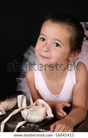 Cute brunette girl wearing a ballet costume - stock photo