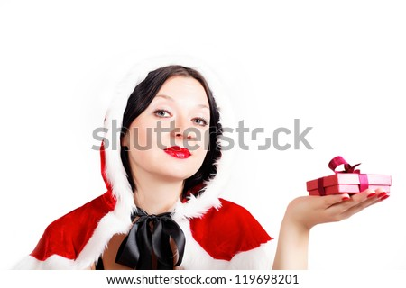 cute brunette has prepared a Christmas gift isolated - stock photo
