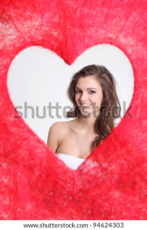 Cute brunette in a love shape - stock photo