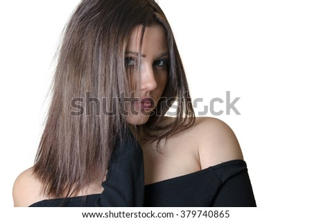 Cute brunette lady wear strapless shirt, looking at the camera with her hand on neck
