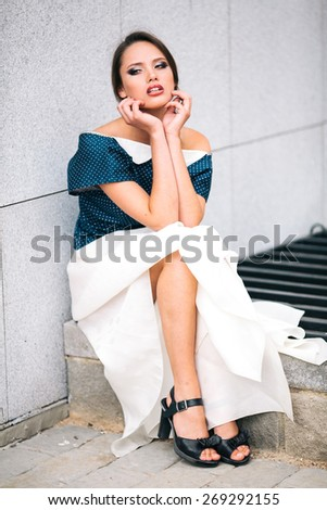 cute brunette model posing near the wall - stock photo