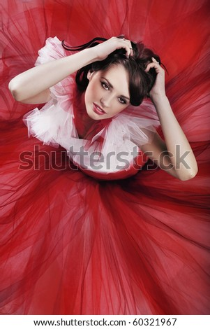 Cute brunette wearing red dress - stock photo