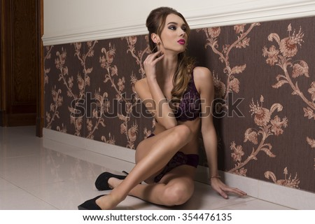 cute brunette woman posing in glamour portrait in elegant ambient with sexy lace lingerie, heels, make-up and long hair  - stock photo