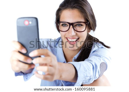 Cute brunette woman taking photo of herself. Isolated. - stock photo
