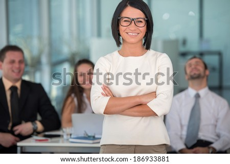 Cute business woman with glasses posing