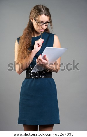 Cute businesswoman holding a documents - stock photo
