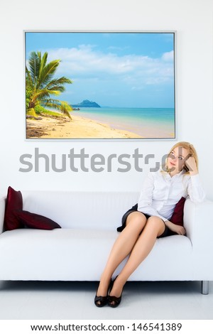 cute businesswoman legs sitting on sofa and dream about vacation - stock photo