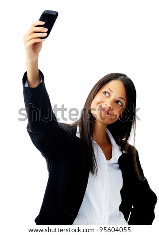 cute businesswoman taking a self portrait with her cell phone - stock photo