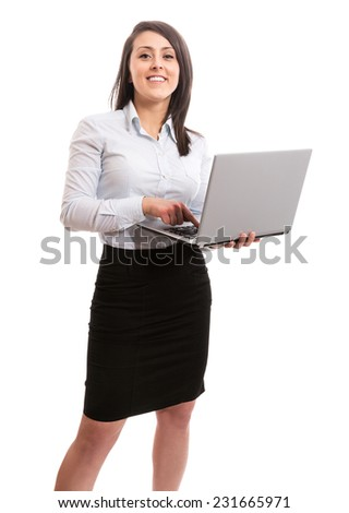 Cute businesswoman with laptop - stock photo