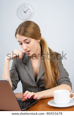 Cute businesswoman working on laptop in the office - stock photo