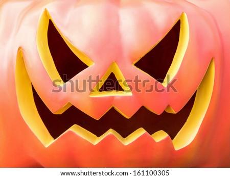 cute cartoon carved Halloween pumpkin lantern with happy smile  - stock photo