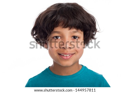 Cute casual mixed race afro caribbean boy standing isolated in studio white background.