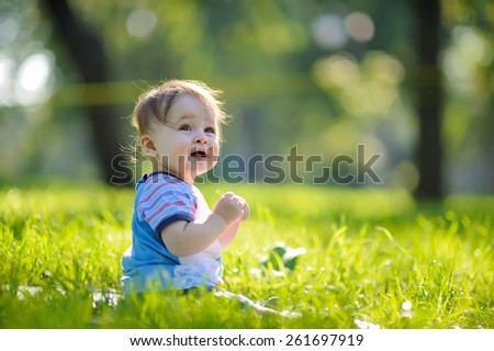 Cute caucasian baby boy in park - stock photo