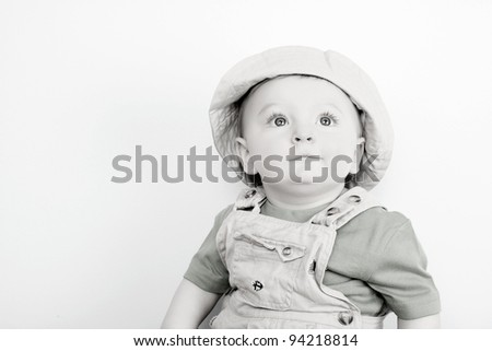 Cute caucasian baby boy wearing a hat - stock photo