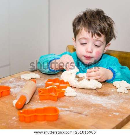 Cute caucasian baby making bread - stock photo