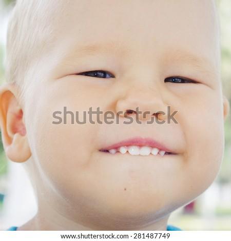 Cute caucasian baby outdoor portrait - stock photo