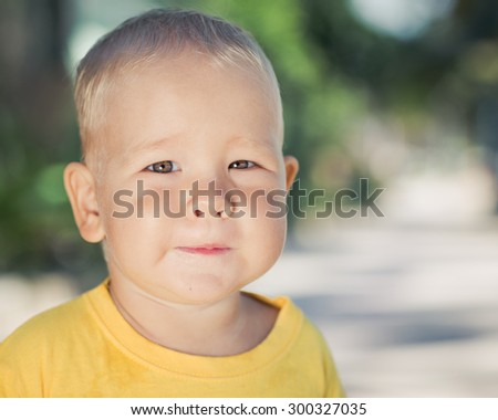 Cute caucasian baby outdoor portrait - stock photo