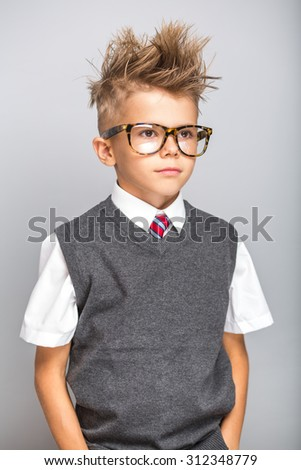 Cute caucasian boy portrait on grey background