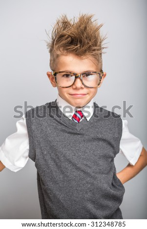 Cute caucasian boy portrait on grey background - stock photo