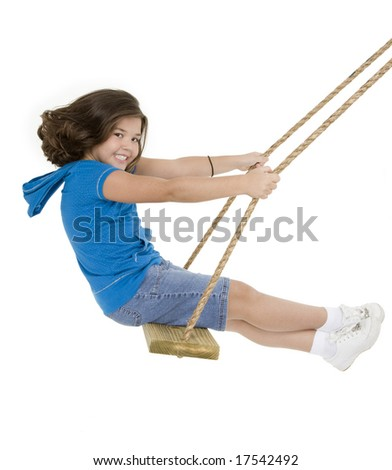 Cute Caucasian child playing on a wooden swing isolated on a white background - stock photo