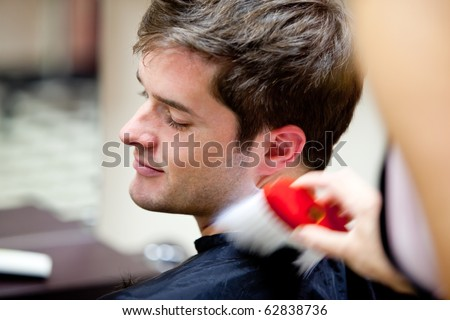 Cute caucasian customer in a hairdressing salon at the end of a haircut - stock photo