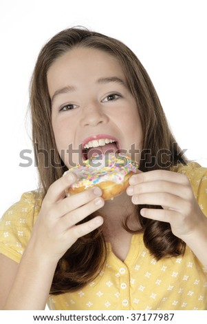 Cute Caucasian girl eating a donut on a white background - stock photo
