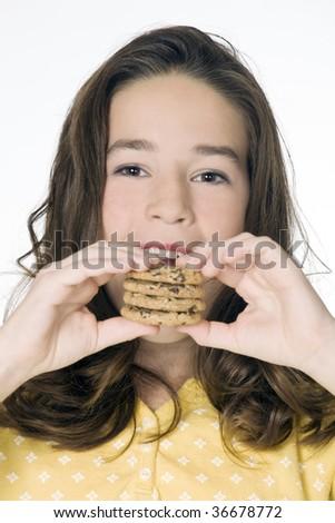 Cute Caucasian girl eating Chocolate Chip Cookies - stock photo