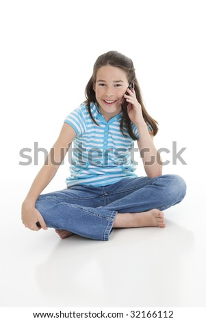 Cute Caucasian girl talking on a cell phone - stock photo