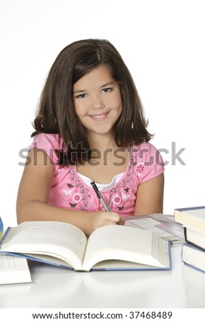 Cute Caucasian girl working on homework