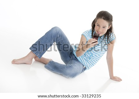 Cute Caucasian girls texting on a cell phone - stock photo
