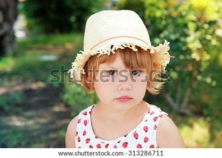 Cute Caucasian little girl in straw hat, outdoor summer portrait - stock photo