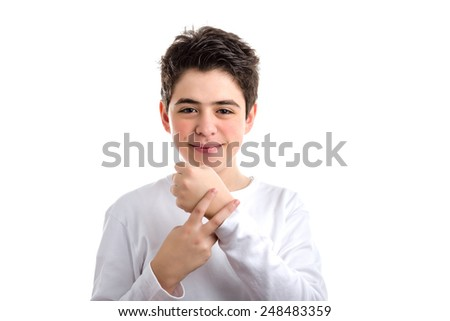 Cute Caucasian smooth-skinned kid in a white long sleeved t-shirt placing index and middle fingers of right hand on left wrist